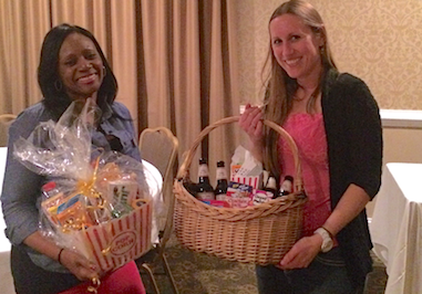 Raleigh Jaycees Gina Allums & Jenna Waggoner show off the Cardinal Corps raffle baskets they won